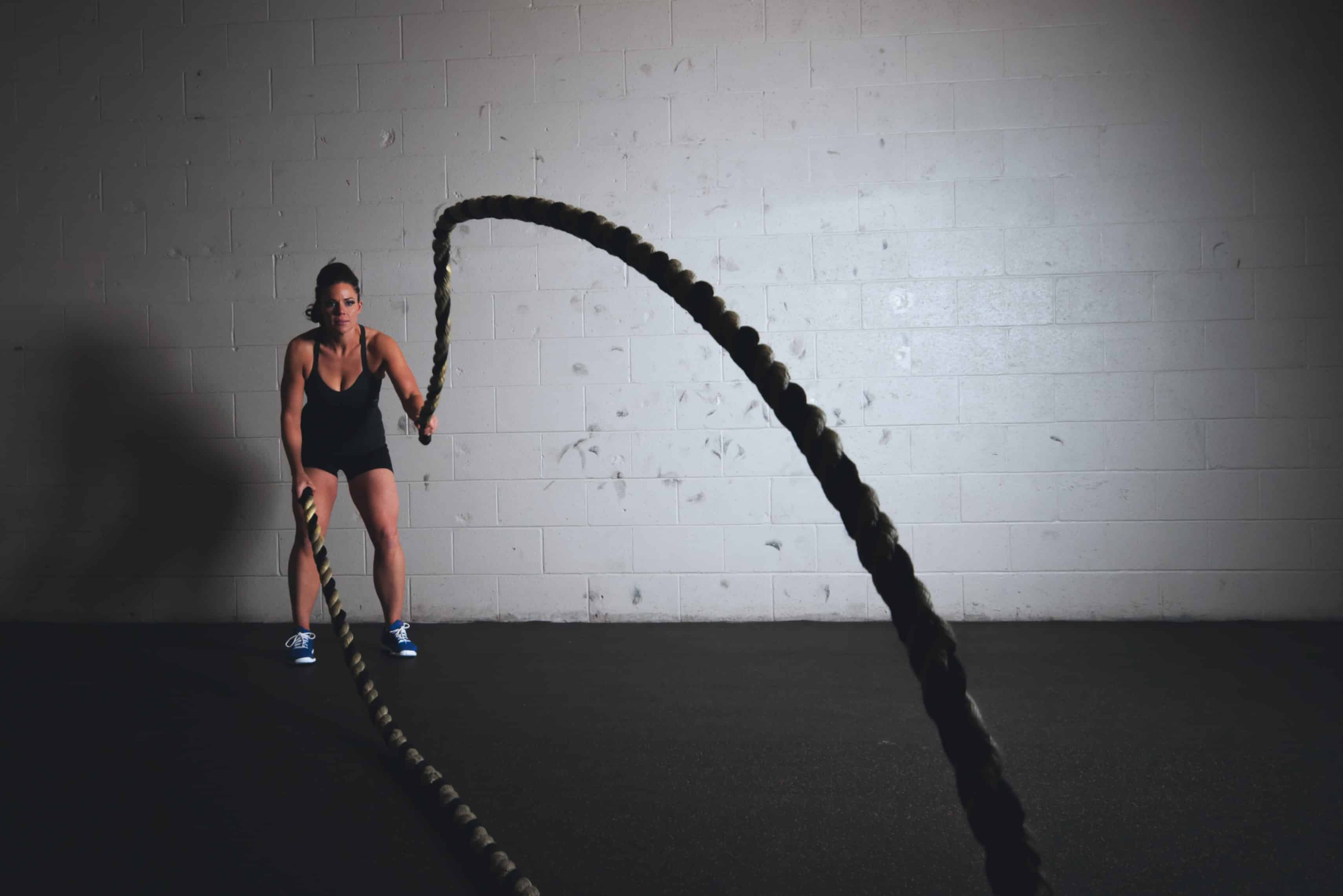 Personal trainer in Northampton using battle ropes during crossfit